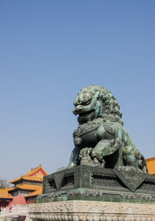 Bronze lion at entrance of The Forbidden City in Beijing, China  photo