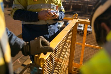 Miners worker looking at personnel risk assessment take five book before written risk assessment prior to work at construction mine site Perth, Australia Banque d'images - 132854501