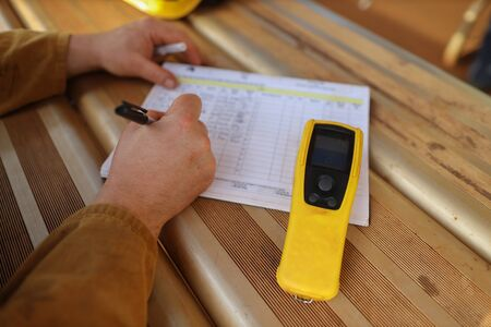 Construction miner writing zero alcohol in the blood system on the daily sheet prior to work