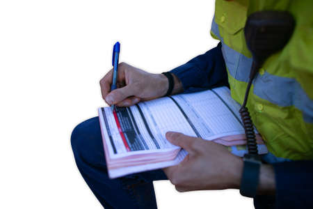 Trained construction supervisor checking reviewing holding pen signing working at height high risk work permit JSA risk assessment on site prior worked with isolated white background
