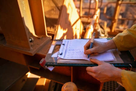 Safe work practices construction worker hand signing safety risk assessment JHA paper permit to work prior performing high risk working at heights task