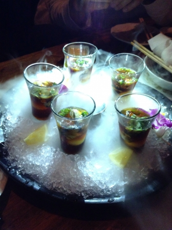 Having oyster shots at a Japanese Restaurant