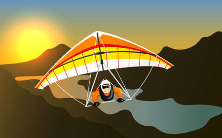 Man having fun on hang gliding extreme sport. Cheerful hang gliding tandem flying in sky