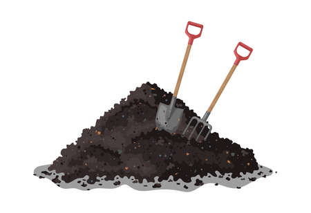 Hay fork and shovel in a pile of ground. Transformation of food waste into fertile soil.