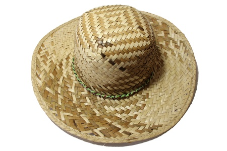 antique straw hat isolated on white background photo