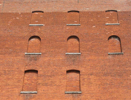 Windows in an old building that have been closed with bricks