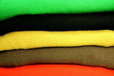 pullovers: Pile of cotton pullovers. Background