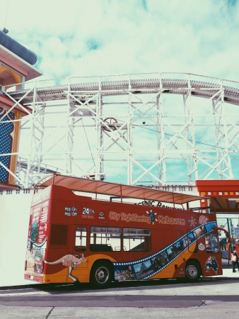 st kilda: Tourism double decker bus at Luna Park of St Kilda
