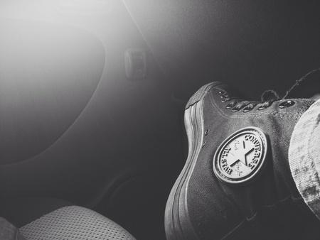Black converse shoe with sun flare  Banque d'images