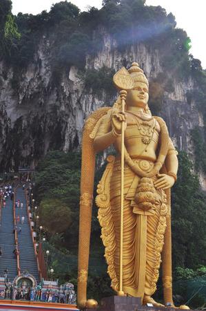 divinity: Batu Cave and Murungan Statue with rainbow flare
