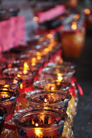 Burning candles light at a Buddhist temple photo