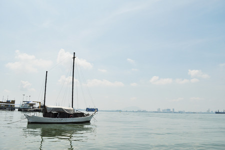 Yacht in the sea around Chew Jetty, Penang, Malaysia photo