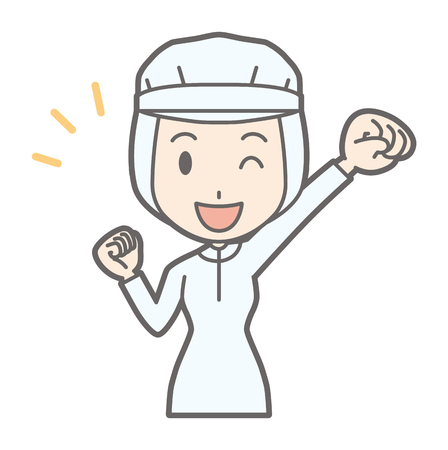 A female worker is smiling with a fist raised
