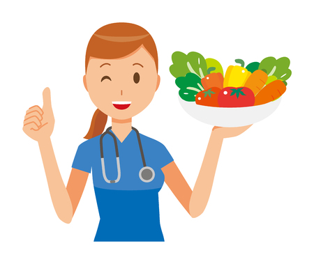A woman nurse wearing a blue scrub holding vegetables.