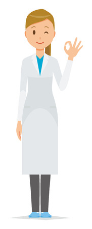 A female doctor wearing a white coat doing an okay sign.