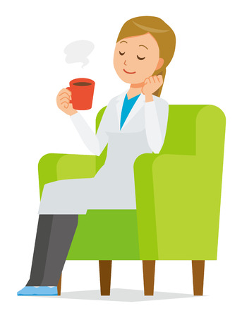 A woman doctor wearing a white suit sits on a sofa and is drinking coffee.
