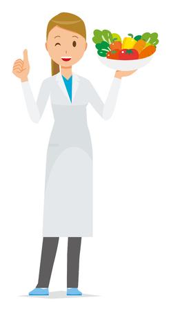Une femme médecin vêtue d'un costume blanc a des légumes.