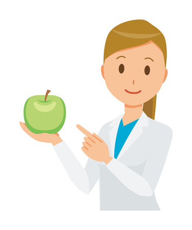A female doctor wearing a white coat has a green apple.