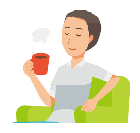 A man wearing a short sleeve shirt sits on the sofa and is drinking coffee