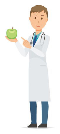 A young male doctor wearing a white suit has an apple