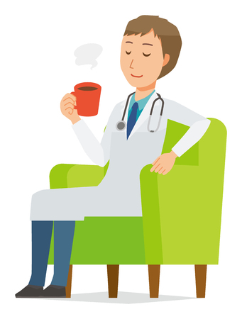 A young male doctor wearing a white suit sits on a sofa and is drinking coffee