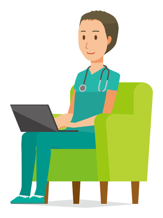 A male doctor wearing a green scrub sits on the sofa and is operating a laptop computer