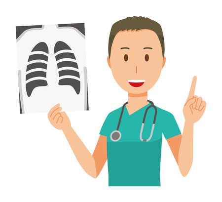 A male doctor wearing a green scrub has an x-ray picture.