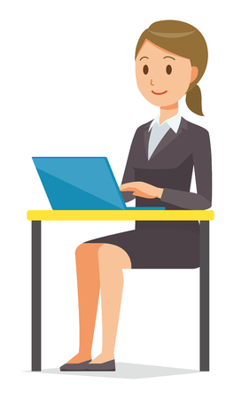 A business woman in a suit is operating a laptop computer