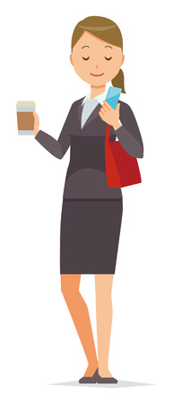 Business woman in suit wears holding coffee and is manipulating smartphone.