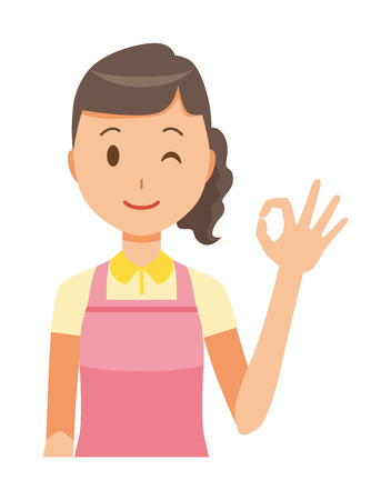 A female home helper wearing an apron is playing an okay sign