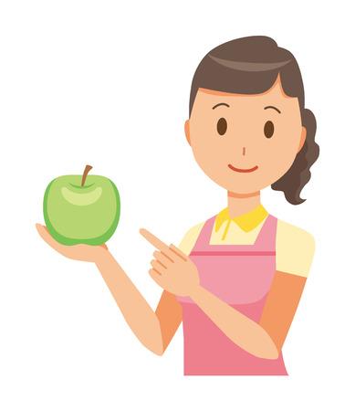 Un aiutante domestico femminile che indossa un grembiule ha un'illustrazione di mela.