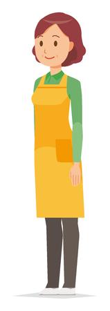 Eine Hausfrau mittleren Alters mit einer Schürze steht schräg