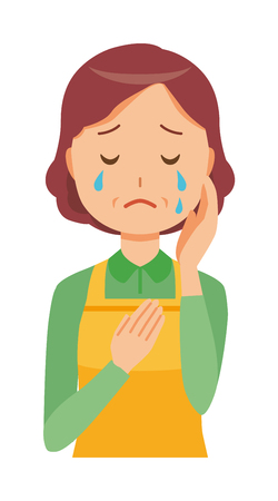 A middle-aged housewife wearing an apron is crying