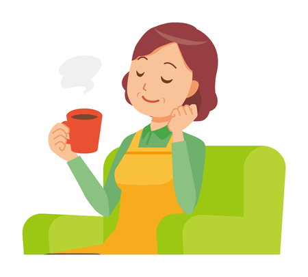 A middle-aged housewife wearing an apron is sitting on a sofa and drinking coffee Reklamní fotografie - 97353950