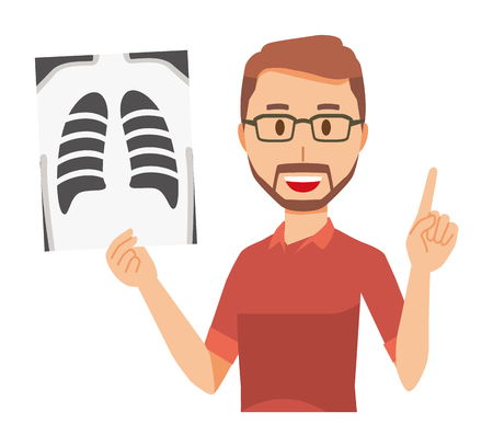 A bearded man wearing eyeglasses has an X-ray picture