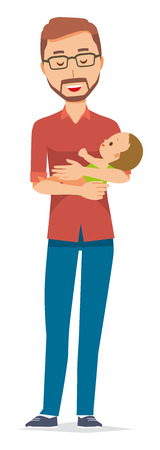 A bearded man wearing eyeglasses holds a baby in his arm
