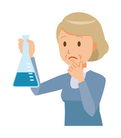 An elderly woman wearing blue clothes has an erlenmeyer flask