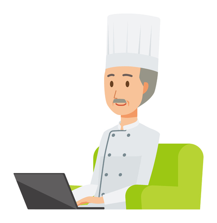 An elderly male chef wearing a cook coat is sitting on a sofa and operating a laptop computer