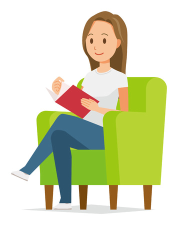 A long hair young woman is reading on a sofa