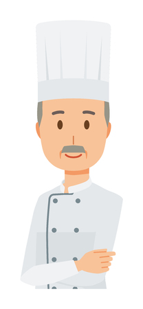 An elderly male chef wearing a cook coat is standing with his arms folded