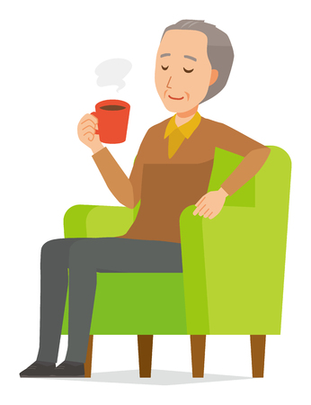 An elderly man wearing brown clothes is sitting on a sofa and drinking coffee