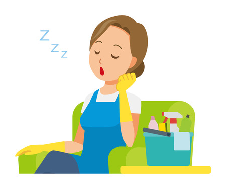 A woman wearing a blue apron and rubber gloves is falling asleep sitting on the sofa