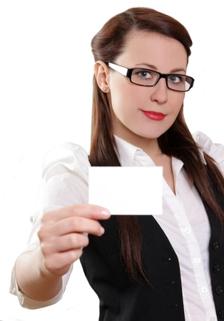 Woman holding out business card and smiling. photo