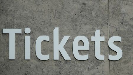 Word Tickets at wall is grey in color. Close up