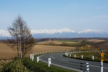 Spring rural areas and mountains Tokachidake Mountain Range Stock Photo