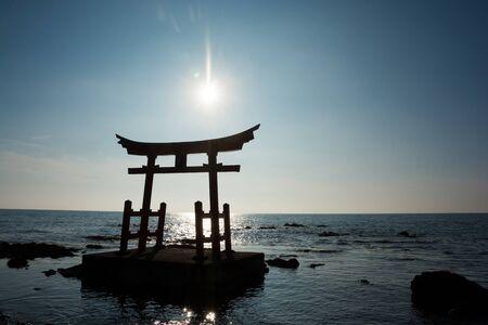 Torii of a Japanese shrine facing the sea Stock Photo