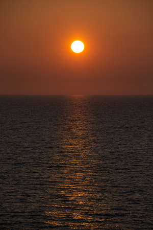 Sea surface where the setting sun reflects