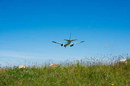 Hay bales and blue sky and jet airliner Stock fotó