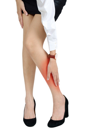 calf pain: A woman holding her calf in pain, with red highlighted on pain area on a white background