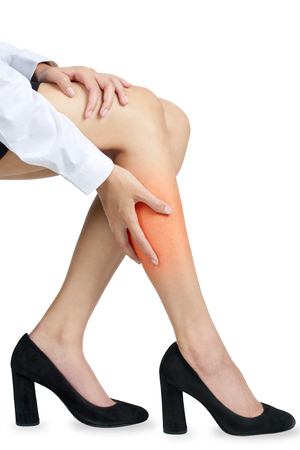 corpo umano: A woman holding her calf in pain, with red highlighted on pain area on a white background